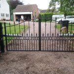 Single bow driveway gates