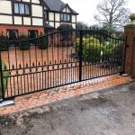 Windsor double driveway gates with circles